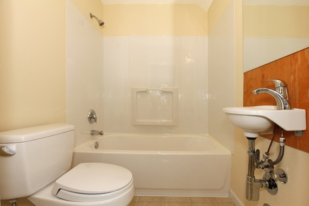 Simple bedroom with plastic tub abd tiny sink Stock Photo - 12312585