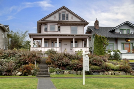 Victorian large house  with large covered porch for sale photo