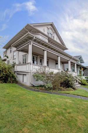 front house: Large Victorian house with covered porch