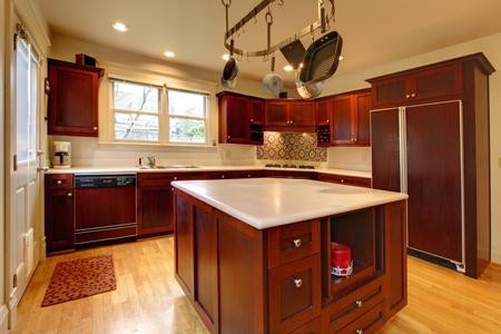 Luxury cherry kitchen with pot rack and island Stock Photo - 12312592