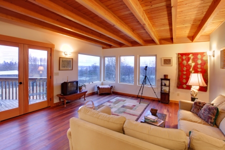 cherry hardwood: Modern luxury living room with wood ceiling and large windows