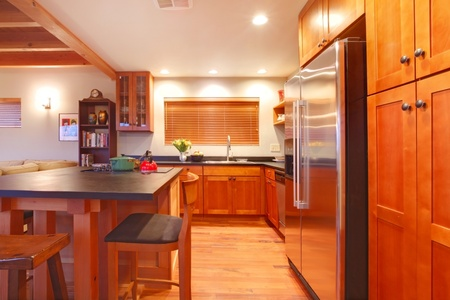 Very nice modern cherry kitchen in the evning light Stock Photo