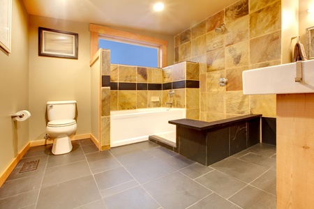 Yellow tiles, black floor and modern design of the large bathroom photo