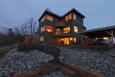 Large modern house in the evening with all lights on photo