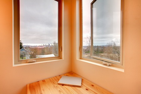 Double window with view of winter forest and city at the distance Stock Photo - 12312673