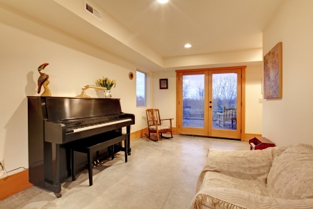 Room with black piano and large door in the evening photo