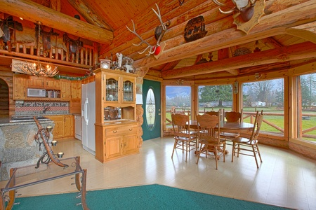 Rustic log cabin on the horse farm dining room and kitchen photo
