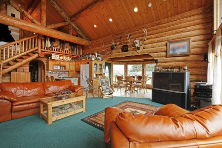 Large living room of the log cabin with cowboy style Stock Photo - 12312291