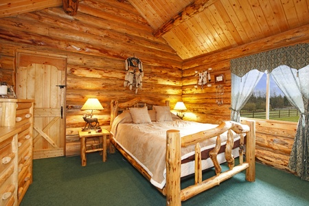 Log cabin bedroom with rustic wood design Stock Photo - 12312406