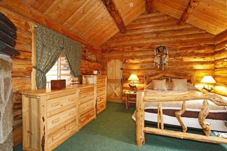 rustic: Log Cabin with large furniture and rustic feel.  Stock Photo