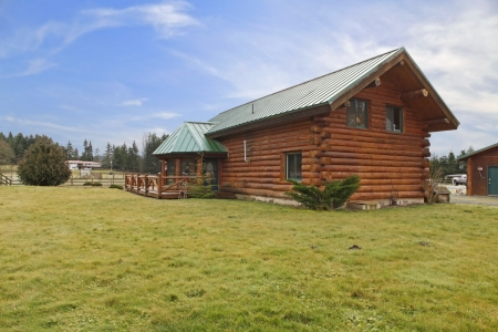 Cabin on a horse farm - exterior shot with lots of land photo