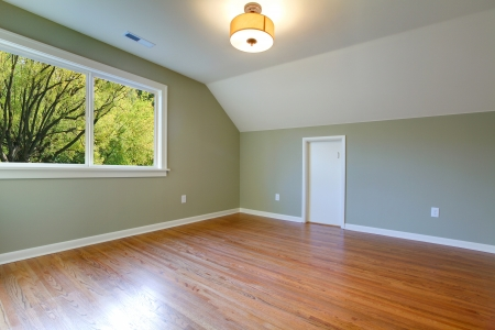 unfurnished: Empty new green room with nice hardwood floor