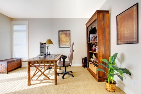 Tropic style home office with beige  photo
