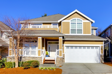 front of house: Large new house with sunny happy landscape