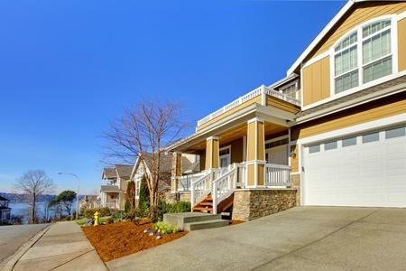 Large yellow happy new house near Seattle, WA Stock Photo - 12312478