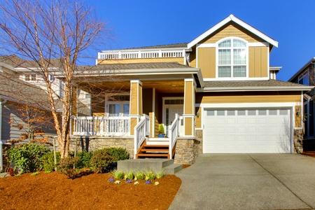 white trim: Yellow mustard house with white trim and spring landscape.