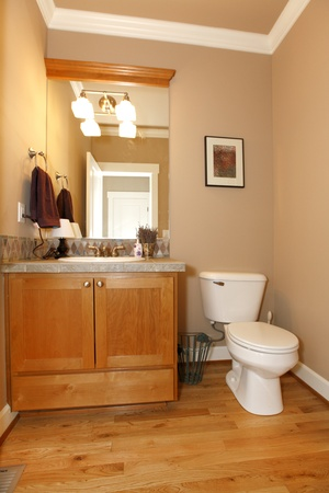 Beige powder restroom with nice hardwood floor. Stock Photo - 12312473