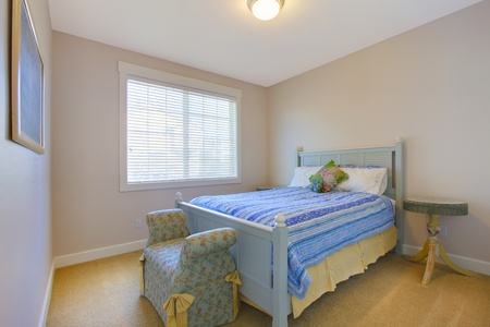 Nice clean blue and beige bedroom Stock Photo - 12312421