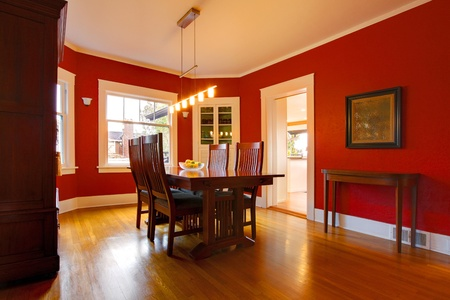 Red dining room house interior. Stock Photo