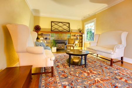 Yellow bright elegant living room. photo