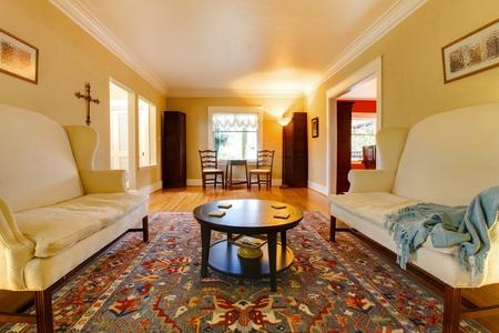 classic living room: Yellow bright elegant living room.