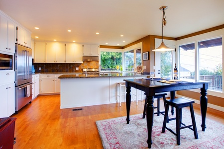 Large white kitchen and table. Stock Photo - 12295649