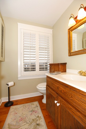 Bathroom with wood cabinet. photo
