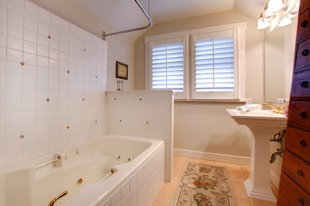 Nice bathroom with white sink and tub. photo