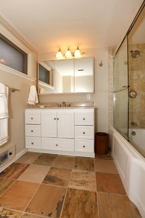 Nice Bathroom With White Cabinets And Shower. Photo