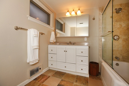 powder room: Nice bathroom with white cabinets and shower. Stock Photo