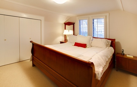White bedroom with large white bed. photo