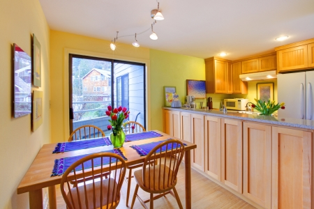 Kitchen with wood cabinets and bright green walls. Stock Photo - 12311636