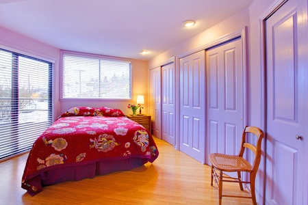 stock photo   tulip: Lavender purple bedroom with pink bed.