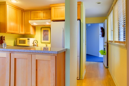 Kitchen with hallway and open entrance door. Stock Photo - 12311628