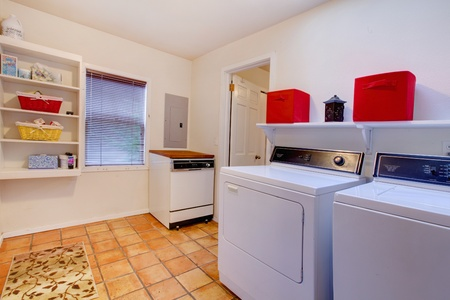 laundry room: Laundry room with three washer and dryer. Stock Photo