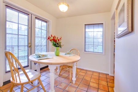 Dining room table with tile and french door. Stock Photo - 12311649