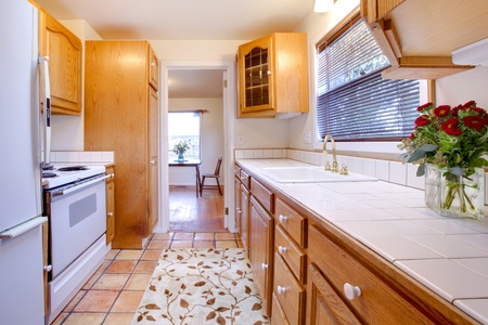 Cozy small kitchen with tile floor. Stock Photo - 12311727