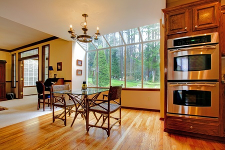 Kitchen stoves and breakfast table.