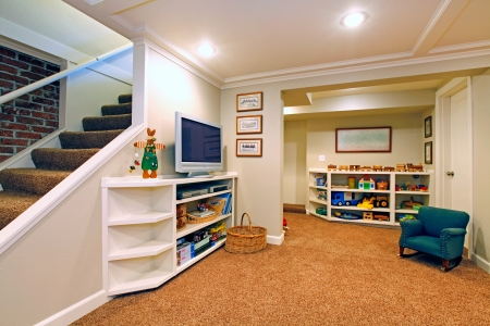 basement: Play room in a  white basement living room