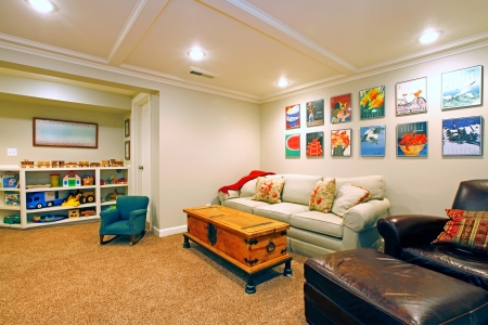 Play room in a  white basement living room photo