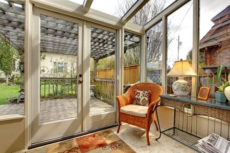 Garden room wall with chair and deck photo