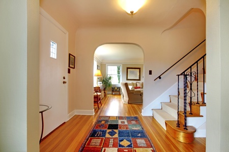 Hallway with large staircase and dinign room photo