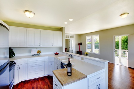 Large room with kitchen bar photo