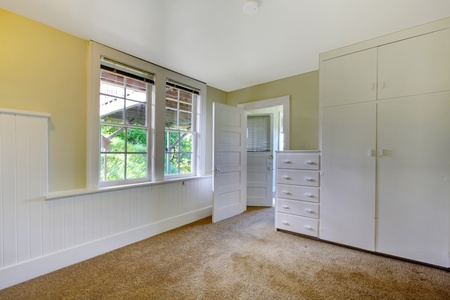Empty white window with closet and window Stock Photo - 12312142