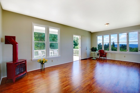 Empty white room with closet and window