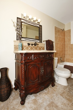 bathroom with nice cherry cabinet photo