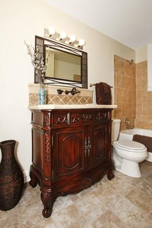 bathroom with nice cherry cabinet photo