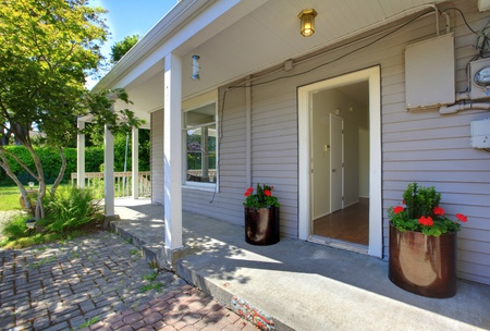 Summer deck of the grey house with railings. Stock Photo - 12312176