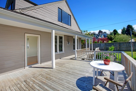 Summer deck of the grey house with railings. Stock Photo - 12312159