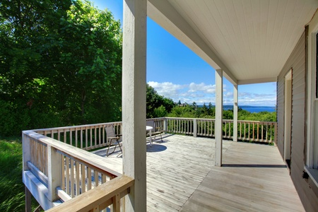 Summer deck of the grey house with railings. Stock Photo - 12312160